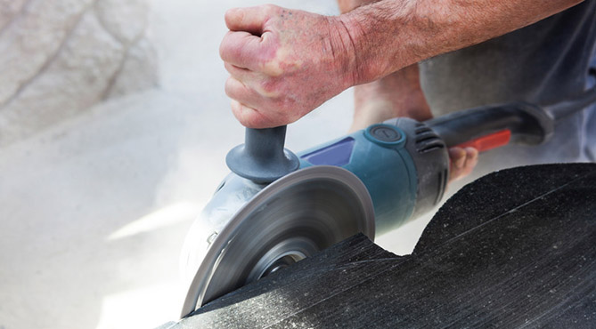 Man cutting Granite Stone